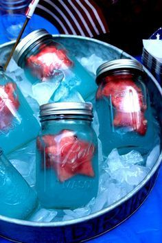 Like the filled mason jars but I would do a different drink, blue Curacao. 4th of July Party Ideas