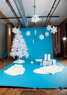 Christmas setup for studio! LOVE the hanging snowflakes!!