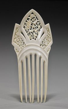 """Old Chinese Carved Ivory Hair Ornament Early 20th Century, carved ivory comb hair ornament, probably Chinese Export; with openwork bird and floral designs, inlaid eyes; L: 7"""""""