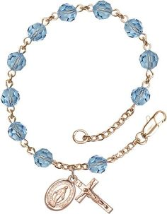 14kt Gold Filled Rosary Bracelet features 6mm Aqua Swarovski beads. The Crucifix measures 5/8 x 1/4. Each Rosary Bracelet is presented in a deluxe velvet gift b