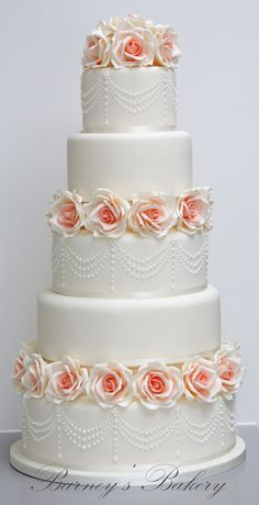 Ivory and peach 5 tier wedding cake. Its not much from this cake but it still looks great.