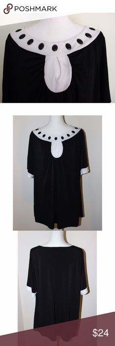 "Lane Bryant Keyhole Neck Tunic The black oval embellishments lining the neck of this top, along with the teardrop hole, make this top adorable! It is made of 93% polyester and 7% spandex, and it is stretchy and very flattering. Measurements: Bust 52"", hips 50"", waist 56"", and it is 29"" long. The tunic is brand new with tags from Lane Bryant and is size 22/24. Lane Bryant Tops Tunics"