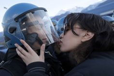 Nov. 16, 2013. A demonstrator kisses a riot police officer during a protest in Susa, Italy against the high-speed train (TAV in Italian) line between Lyon and Turin. (Marco Bertorello—AFP/Getty Images)