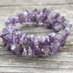 Spiral bracelet with Amethyst chips. This Amethyst is a transparent, sometimes milky stone in light to dark purple with light to dark gray bits. by StudioPaars on Etsy  #StudioPaars