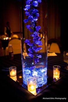 This is really pretty for inside the vase... uplit submergeable tealight with flowers... blue wedding flowers