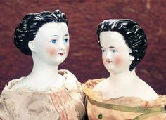 """Theriault's Antique Doll Auctions - German Porcelain Lady with Very Elegant Demeanor 21"""" ~ circa 1875 with German Porcelain Lady Doll with Elaborately Sculpted Black Coiffure 20"""" ~ circa 1870"""
