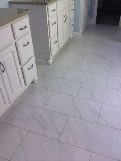 Daltile Florentine - they have it in a variety of sizes. Not sure what it looks like in person but I love that it wouldn't have the maintenance of marble!