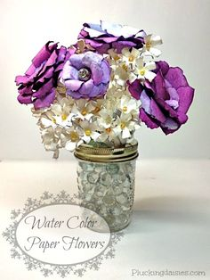 I've been hard at work on some new paper flower designs for my best friends wedding. Today I will be sharing some trade secrets on how to make paper flowers using the Tim Holtz Tattered Florals Si...