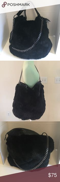 Abro Black genuine leather fur hobo This is a stunning Abro genuine leather shoulder bag with for. Gunmetal silver chain strap with 13 inch drop. Also has leather top handle that is adjustable. Zip top closure. Black lining with zipper pocket and slip pockets inside. Like new condition other than light scratches on the hardware. Made in Romania abro Bags Shoulder Bags