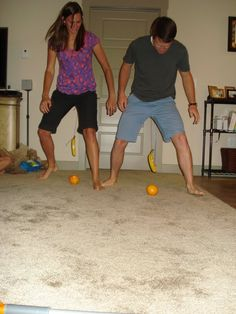 "Players ""both had a string tied around their waist that was tied to a banana. They then had to knock the banana into an orange, and push the orange across the room and over the finish line, by just swinging their hips to swing the string attached to the banana. It was pretty awesome to watch!"""