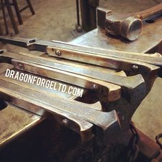 Got the #forged #bronze riveted on the #fireplace tool handles. Was a bit tricky but this challenge gave me some ideas of riveting under the power hammer as I had a quick makeshift set up. Good night! #blacksmith #blacksmithing #dirtysmith #maker #metalart #interiordesigns