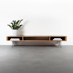 """Mid century wide TV stand or coffee table. Minimalist solid oak on hairpin legs """"Marston"""" - Our Marston extra wide TV stand or long coffee table is an extra wide, low looped, minimalist piece - Low Coffee Table, Modern Coffee Tables, Mid Century Coffee Table, Coffee Coffee, Living Room Tv, Living Spaces, Tv Stand Ideas For Living Room, Solid Oak Table, Solid Wood"""
