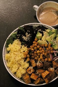 Buddha Bowl with millet, roasted beet, chickpeas and sweet potato and a tahini sauce