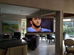 This is a 60″ LED television mounted into a custom enclosed frame, designed and built by AIC. Our client wanted a television they could see from their living and dining room. We suspended the A/V framework from an extremely quiet and easy to operate ceiling track system. This completely mobile track system has the ability to rotate a full 360 degrees. We were able to surprise and exceed our clients expectations!