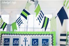 Use banners along windows, whiteboards, or criss cross them over the center of your room to pull your theme together! Preppy Nautical Monogram stripes polka dots sailboats anchors whales classroom decor and themes by Schoolgirl Style www.schoolgirlstyle.com