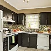 Brown Painted Kitchen Cabinets black painted cabinets with white appliances. this convinces me