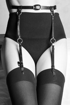 I want these so hard!! Suspenders already have a lovely 'naughty factor' but the leather is just wow!