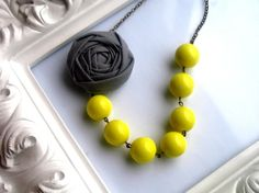 love this fabric flower necklace with canary yellow beads!