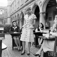 1940s dress design program students at Washington University in St. Louis critique a plaid dress.  Photo by Nina Leen. (via Life photo archives)