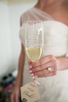 Make sure you get a photo of yourself holding a champagne flute at your wedding to show off your ring.
