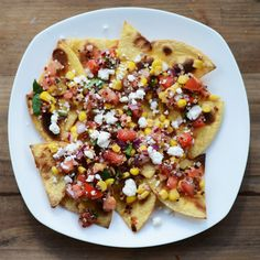 What makes a nacho a nacho? Is it because there is a giant bed of chips with tons of stuff on top? Or because of the cheese? Either way, normal nachos are usully not-cho healthy. This is how ...