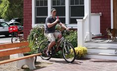 Bicycling by the Cape May General Store in Cape May Point, N.J.  (Whitney Tressel) From: Coolest Small Towns 2012. Click on the photo to nominate your favorite small town for 2014's contest!