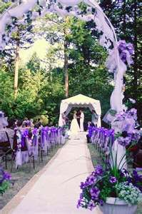 Beautiful purple wedding. I like the arch for the entrance and gazebo at the end for bride and groom to stand under.
