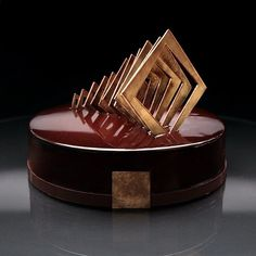 """Cake """"Tonka-chocolate"""". Inside the soft chocolate biscuit without flour with pine nuts, crispy layer with paillete feuilletine and praline, white chocolate mousse, milk chocolate mousse with Baileys, dark chocolate mousse with tonka beans."""
