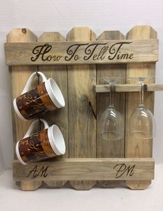 "Rustic blue pine How to tell time, AM PM sign, coffee mug and wine glass rack, wood burned coffee wine sign. This rustic How to tell time coffee wine sign is perfect for the real wine lover! This coffee mug, wine glass rack measures 20"" x 17""appx. It has the words ""How to tell time "" forever burned into the wood. It has been stained with minwax 3 in 1 stain, sealer, and protectant and the color is weathered oak . It has a coating of lacquer to help preserve the wood. Each rack will vary..."