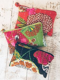 """This cute soft fabric pouch is made from a traditional quilted Indian fabric called Kantha. Made of 100% cotton. Measures 5"""" H x 8"""" W. Features a zippered pom-pom closure at top. Created by Blue Mango"""