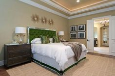 Image Source: Hgtv - The opulent green color in combination with the velvet fabric and tufted design has made this headboard a perfect element for creating a chic and modern bedroom. - Rilane