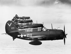 Helldiver formation SB2C-4E Helldivers from Bombing Squadron 87 (VB-87) in formation over the Pacific. The squadron was assigned to USS Ticonderoga (CV-14) from May-September 1945.