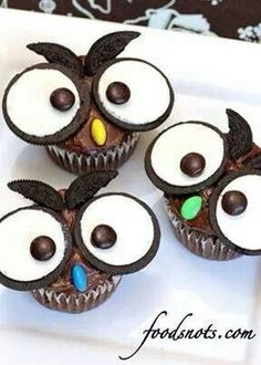 """#Owl #cupcakes!! Could tweak the recipe so I used almond pieces for the beak to cut back on the sugar and I got the """"spring"""" oreos instead. So the eyes were bright yellow rather than white."""