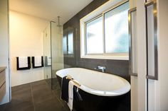 Incorporate dark elements into your bathroom for a stylish, modern and enclosing space.
