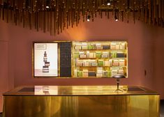 An assemblage oftimber battenscovers the ceiling of skincare brandAesop's newest store in Singapore, designed by architecture firm Snøhetta