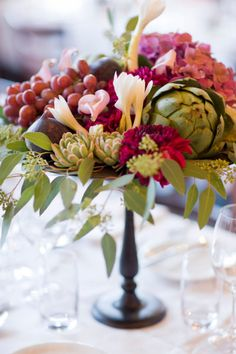 the beauty of artichokes, grapes and succulents in a centerpiece