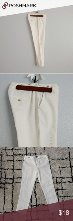 "NWT GAP ivory tuxedo pants NWT ivory tuxedo pants from the gap. slim, skinny fit throughout leg, stretchy material. features stripe down the leg. waistband adjustable with buttons.   there is a small stain on the right knee area (see last photo).  size 4 waist - 16"" rise - 9"" inseam - 26.5"" GAP Pants Skinny"