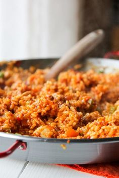 Chicken and Chorizo Paella Recipe. I would substitute the chorizo with shrimp and take out the tomatoes.