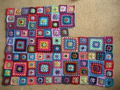Layout:  Sweet Flower granny blanket in progress, by Lucy of Attic24.  Squares are the same pattern: big squares - 8 rounds, small squares - 4 rounds.  #crochet #granny_square #afghan #throw