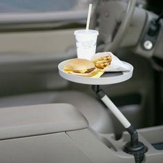 Keep all your food, snacks, pen and paper at the tips of you fingers while on the road with the Car Swivel Tray. The tray swivels with ease back and forth from driver to passenger, and locks securely