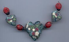Gorgeous polymer clay bead set made by the artist Ivy Koehn. $30.00, via Etsy.