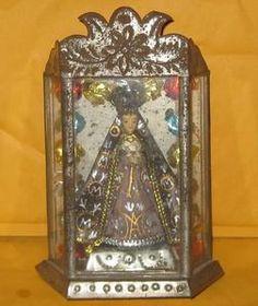 Vintage tin Mexican nicho with santo Virgen de la Soledad.