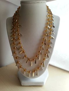 Double stranded beaded and gold metal charms necklace/ Gold statement necklace on Etsy, $14.00