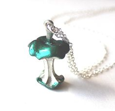 Necklace apple silver and emerald green eaten core by Bunnys, $26.00