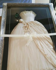 We are in Love with this Wedding dress we got to frame from a beautiful bride! 10 years old but so classic any new bride I'm sure wouldn't be able to resist this one! Contact us today for Wedding Dress framing @ the beautiful frame company