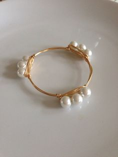 The Lucille gold bauble bangle on Etsy, $12.99