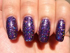 SolarClub Festival - a holographic glitter polish that changes colour in sunlight. Indoors: silvery lilac holo glitter. Outdoors (this pin): deep purple holo glitter. Click the image for more!