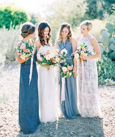 Mix-and-match bridesmaids let their personal style shine! Blues and grays in the dresses, pinks and corals in the flowers.