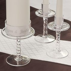 Our Personalized Glass Pedestal Unity Candle Stand has all the right curves to add magic to your big day! Crafted of clear glass, this candle stand set will look great displayed at everything from your ceremony to your fireplace mantle. Set includes a glass stand for a 3 inch wide unity candle and two glass stands for taper candles.