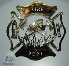 Firefighter Metal Maltese Cross Style Wall Decoration by The McInnis Group, Inc.. $28.95. 14-1/2 Inches Wide. 14-1/2 Inches Tall. Tough all metal design. Backside hidden hook for hanging. Rough finish all metal hand cut firefighter design. Each one is unique with a burned brass finish and a rough cut design to represent the true firefighter.